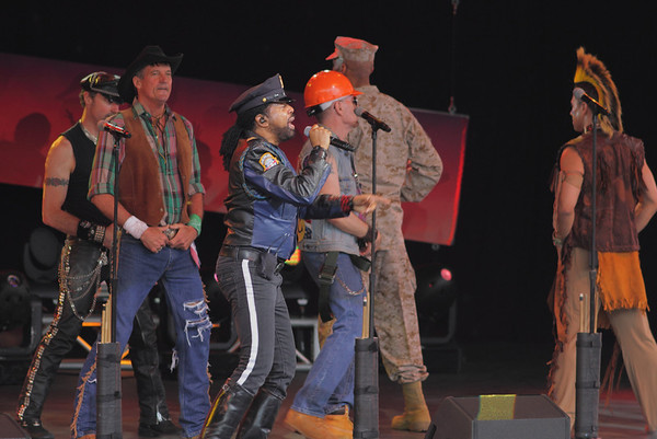 The Village People at Epcot, 2013:  Eric Anzalone (biker), Jeff Olson (Cowboy), Ray Simpson (Cop), David Hodo (Construction Worker), Alex Briley (G.I.), and Felipe Rose (Indian).  Felipe, Alex, and David are from the original group.
